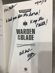 "David signing my copy of ""Warden of the Blade""."
